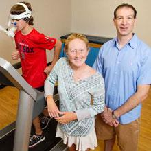young boy runs on treadmill while Professor Hillman and researcher Laura Chaddock-Heyman stand by